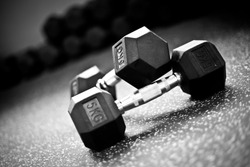 Dumbells on the floor in a gym