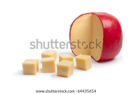 Dutch Edam cheese cubes on white background