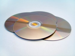 4 DVDs spread out on a white background