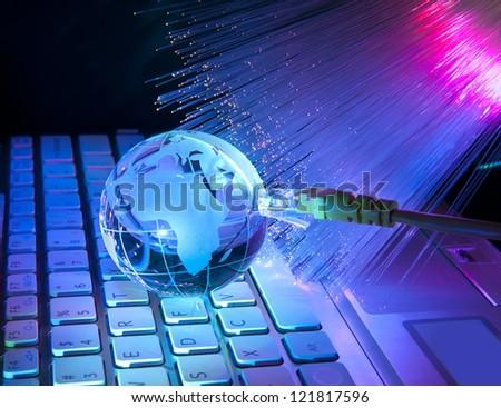 earth globe against fiber optic background