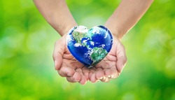 Earth Heart in Hands on Green Blurred Nature background, World Environment Day and Give Love to Our  World Concept, Elements of this image furnished by NASA