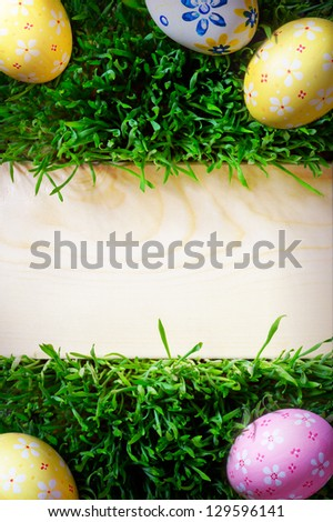 easter background grass and easter eggs