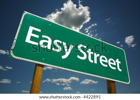 """""""Easy Street"""" Road Sign with dramatic blue sky and clouds."""