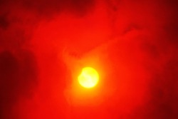 Eclipse of the sun through red glass