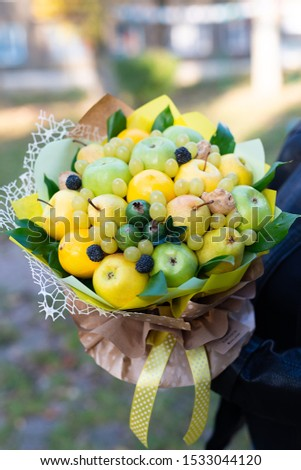 edible fruit bouquet of apples pears elements of green grapes in craft paper #1533044120