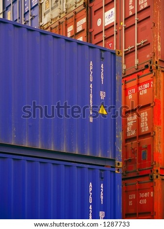(Editorial/News) Close-up of overseas shipping containers stacked in a loading area.
