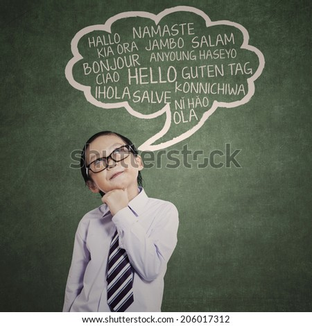 Education concept: schoolboy learn many languages in a classroom