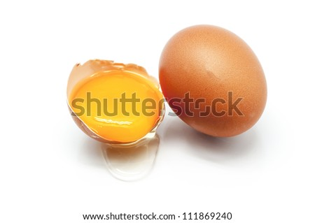 Egg halved with the yolk in the foreground