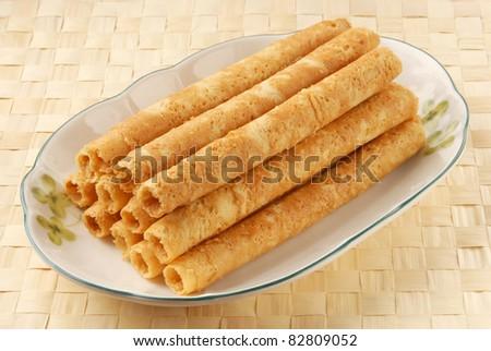 Egg rolls on white plate