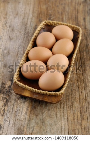 7 eggs in bowl on a wooden old boards  Stock fotó ©