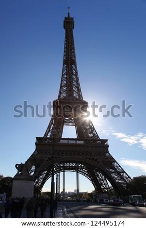 Eiffel Tower against sun in Paris, France