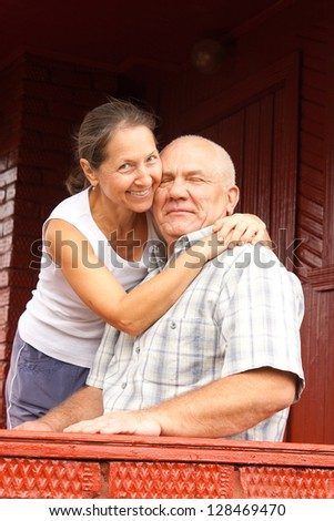 elderly couple sitting on a porch