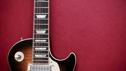 electric guitar closeup . color background