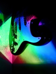 electric guitar in the color stage light
