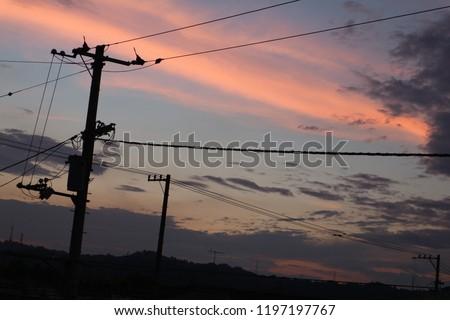 電線と夕焼け / Electrical Wires and Sunset. ストックフォト ©