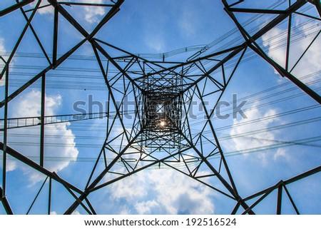 Electricity pylon - light pole and sun