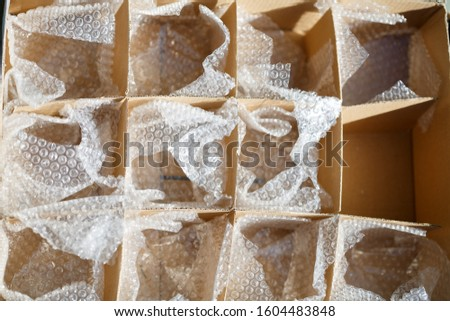empty box with cells containing packaging for packaging