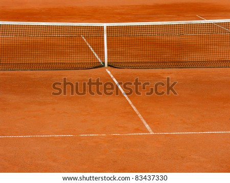 empty clay tennis court in time-out