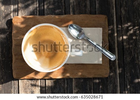 empty coffee cup with stain on wooden table in the park #635028671