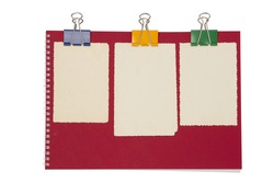 Empty photo on red notepad with binderclip. Isolated on white background \ Empty photo on red notepad