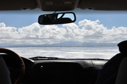Entering by jeep to the Uyuni salt flat, looking like being in the clouds, Bolivia