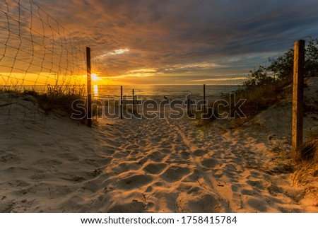 entrance to a sandy beach during a beautiful sunset Stock photo ©