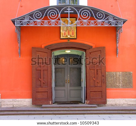 Entrance to russian orthodox church with cross and icon
