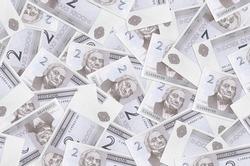 2 Estonian kroon bills lies in big pile. Rich life conceptual background. Big amount of money