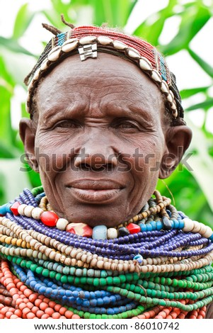 ETHIOPIA - AUG 14: Nyangatom woman posing in the village,the ethnic groups in the The Omo valley Could disappear Because of Gibe III hydroelectric dam. on Aug 14, 2011 in Omo Valley, Ethiopia. - stock photo