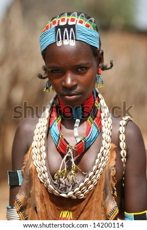 ETHIOPIA UNKNOWN A young female tribal member wearing traditional attire poses for a portrait in this undated image taken in Ethiopia