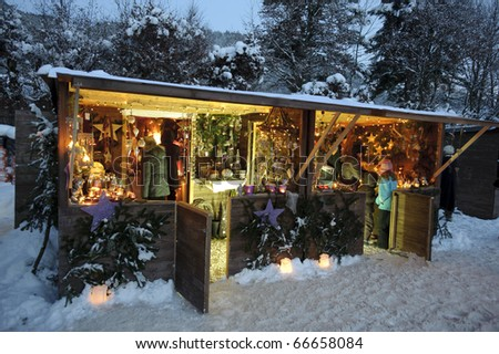 ETTAL, GERMANY - DECEMBER 4: Christmas market with illuminated shops for gift and decoration on December 4, 2010 in Ettal, upper bavaria, Germany