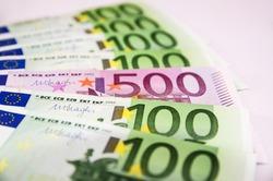 500 Euro banknote among 100 Euro banknotes.