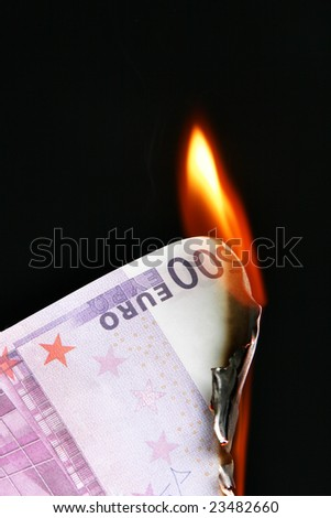 500 euro banknote on fire over black background