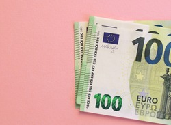 100 euro banknote pack and pink bankground. Currency, financial
