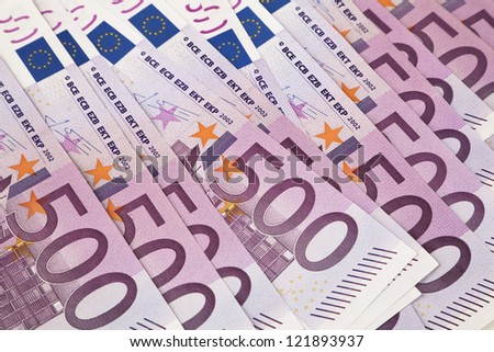 500 euro banknotes in a row. European Union Currency. Stack of 500 euro banknotes.