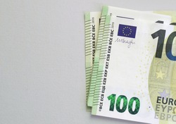 100 euro banknotes on grey background. European currency