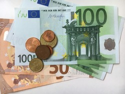 50, 100 euro  cash. Different european banknotes and coins await to be used as cash