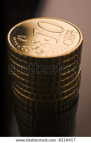 10 euro cent coins stacked on black table