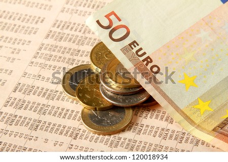 Euro coins and financial newspaper