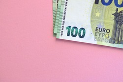 100 euro detail. Pack of 100 banknotes at pink background. Economy, currency