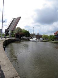 Europe, Belgium, West Flanders, Bruges, lifting bridge and apassing boat
