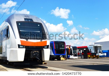 European high-speed passenger train and modern subway rolling stock and tramway on an open  railway area of the rail car assembly plant Stadler - Image ストックフォト ©