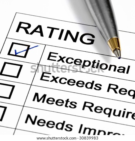 """Exceptional"" rating marked with pen.  Could be performance appraisal, customer service rating, business performance evaluation."