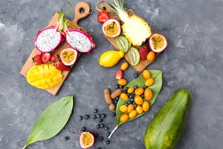 Exotic fruits on a gray background.