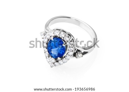 Expensive ring with sapphire and diamonds on white background