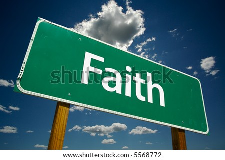 """""""Faith"""" Road Sign with dramatic clouds and sky."""