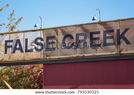 'false creek' welcome sign in...