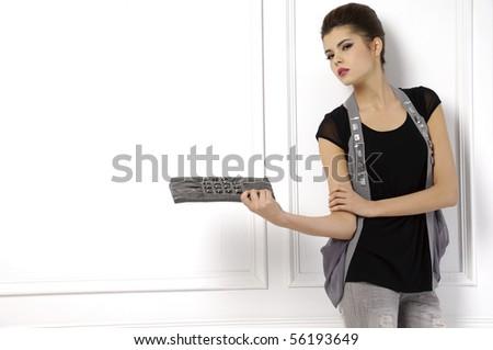 fashion model holding little purse - stock photo