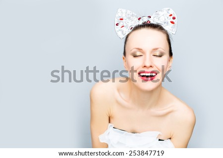 Fashion photo of beautiful woman with big hair accessory silk bow with gem stones