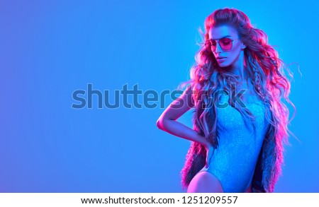 Fashion. Woman in Colorful neon light. Sexy girl in disco bodysuit, makeup dance. Party disco neon nightclub vibes. Fashionable model portrait, creative art neon pink blue light, banner